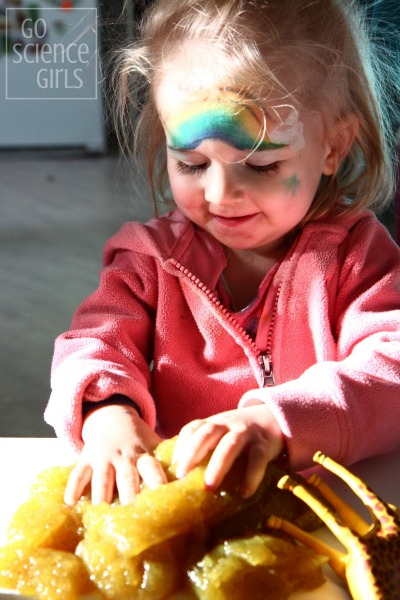 Toddler playing with slime