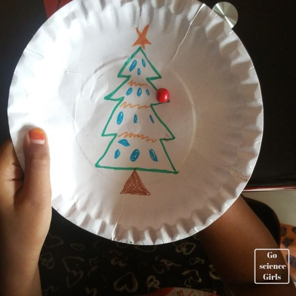 Playing with a DIY Christmas tree magnet maze fun STEAM activity for kids