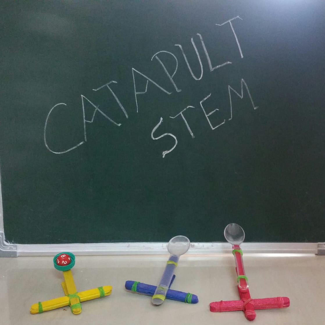 Catapult STEM - fun make your own catapult kids activity that combines science, engineering and math principles with play.