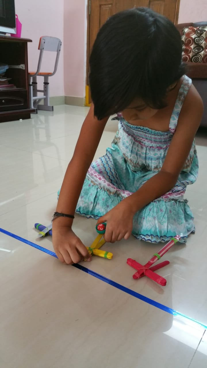 Making and testing catapults - fun STEM activity for kids to do at home, that works on science, engineering and maths through play