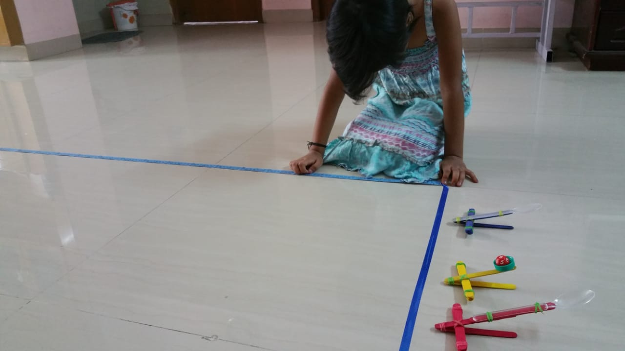 Measuring distance - Catapult STEM activity for kids, that combines science, engineering and maths with play