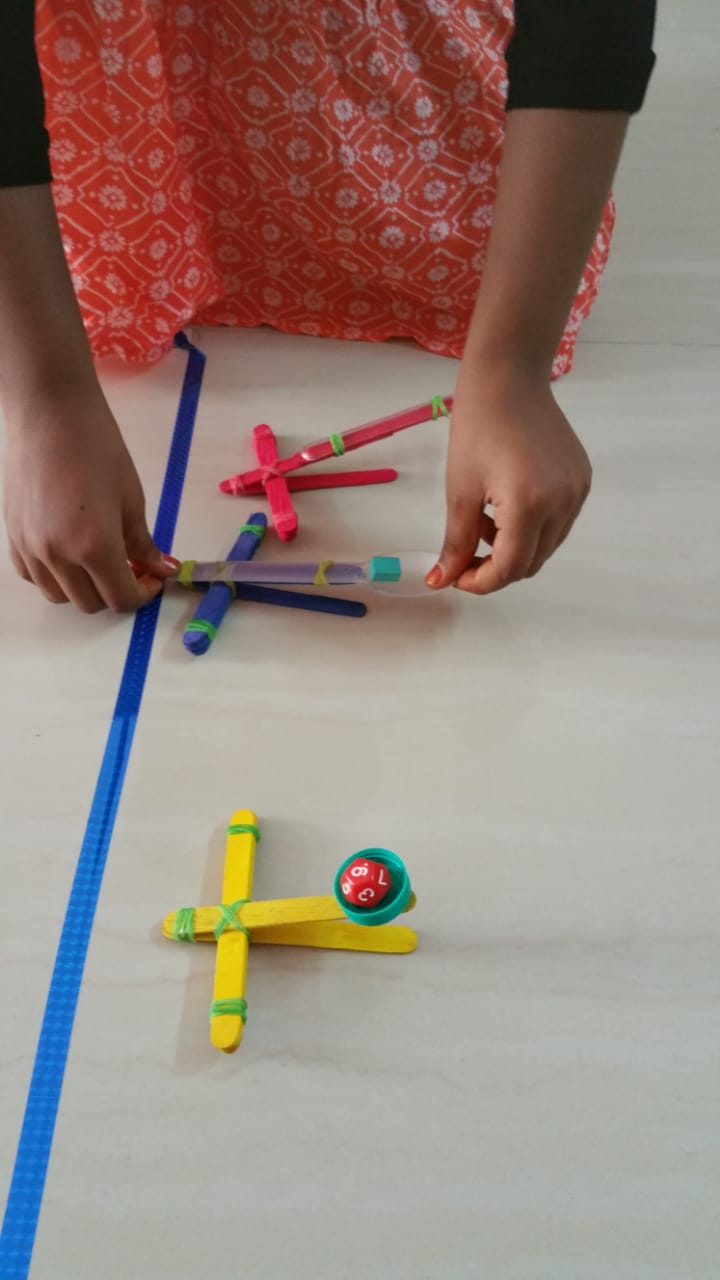 Testing out catapult designs - how high can they go Fun STEM activity for kids