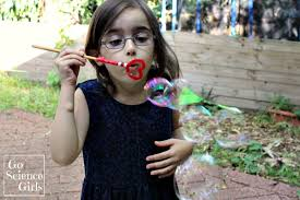 Blowing bubbles with a homemade heart bubble wand