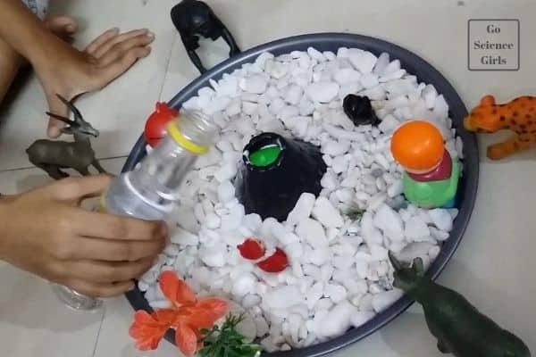 Add vinegar to volcano