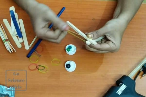 bundle sticks with rubber band for catapult