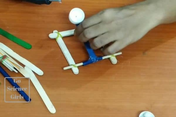 catapult design with spring and ice sticks