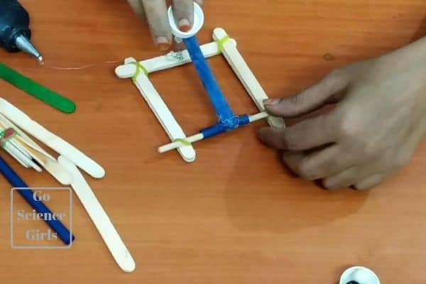 catapult with spring ice sticks in action