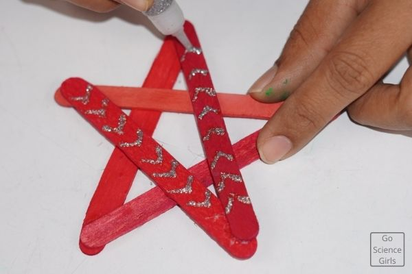 Decorate Popsicle Stick Christmas Star With Glitters